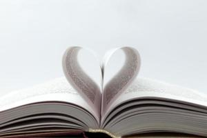 Opened book with heart page photo