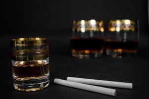 Short Glass of dark red whiskey brandy or bourbon photo