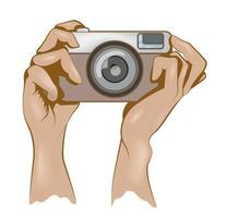 vector image of the hand holding the camera