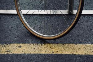 wheel of the bicycle on the street photo