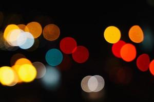 bokeh colorful street lights at night in the city photo