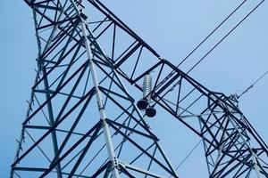 power transmission tower on the street photo