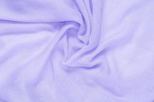 Delicate soft and wrinkled purple fabric photo