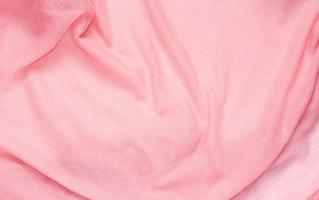 Delicate soft and wrinkled pink fabric photo
