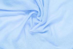 Delicate soft and wrinkled blue fabric photo
