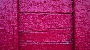 Fondo de textura de madera viejos paneles de color rosa foto