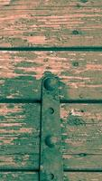 Vertical ancient wooden door background photo