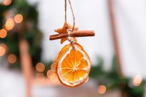 Hanging Christmas decoration of dried oranges photo