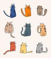 Cartoon hand drawn cats sitting vector