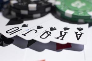 Casino tokens and royal flush photo