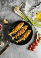 Creative arrangement of cooked fish photo
