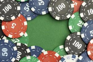 Casino tokens on green background with blank space photo