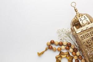 Islamic new year decoration with praying beads and lantern photo