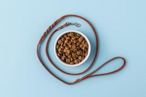 Pet accessories still life with food bowl and dog leash photo