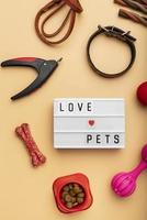 Pet accessories still life concept with love pets text photo