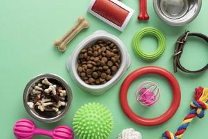 Pet accessories still life with chew bone and toys photo