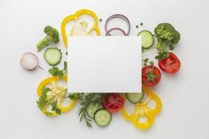 Top view vegetables arrangement on table photo
