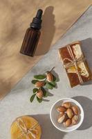 Top view arrangement of argan oil care product photo