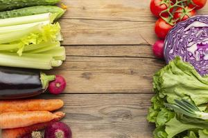 Top view Vegetables on wooden table photo