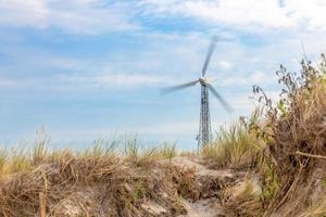 German Baltic Sea coast with wind turbine sand dunes and grass photo