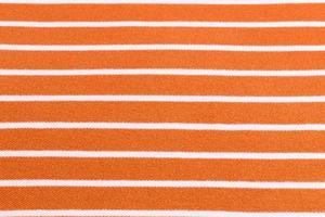 Hermoso fondo de verano hecho de tela naranja a rayas foto