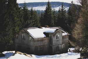 Brown wooden house in mountains photo