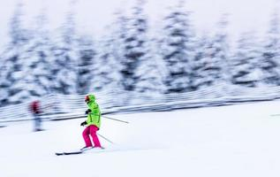 selective focus photography of person on ski blades at ski track photo