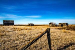 Abonded farm buildings on the prairies Keoma Alberta Canada photo