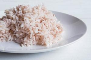 Brown rice and steamed rice on a plate photo