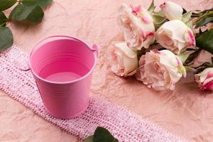 A bouquet of beautiful roses on a pink craft background with space for text photo