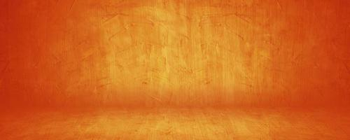 Horizontal yellow and orange grunge texture cement studio or concrete wall banner showroom blank background photo