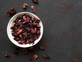 Hibiscus tea in white bowl  Slate background Copy space photo