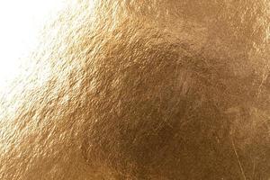 Abstract texture of golden metal macro shot background at close range photo