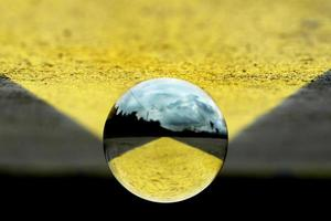 A lens ball on a geometric background photo