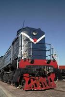 Blue locomotive with red star photo
