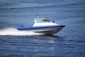 Speedboat cruising in the sea photo