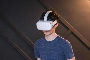 Boy playing virtual reality games with headset photo