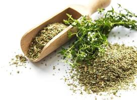 Fresh and dry thyme on white background photo