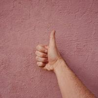 hand gesturing on the wall photo