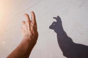 hand gesturing in the shadows photo