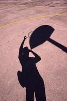 street basket shadows on the ground photo