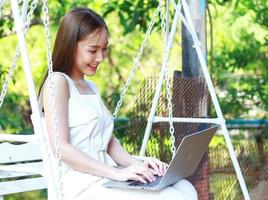 Asian woman working at home with a laptop during COVID-19 outbreak photo