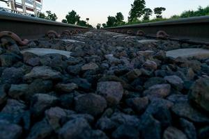 Close up of a rock in the middle of a train track photo