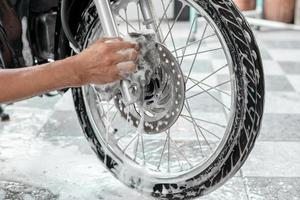 Washing a motorbike wheels photo