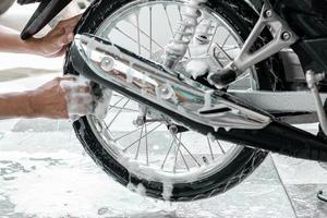 Washing a motorbike rear wheels photo