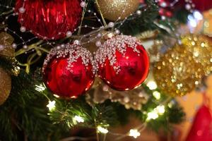 Christmas tree with red and golden ornaments festive winter holiday background photo