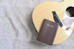 Holy bible on a guitar with a furry background, Christian worship photo