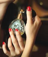 Woman applying perfume photo