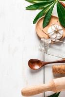 Natural biodegradable kitchen utensils on a white wooden background photo