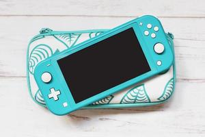 Portable Console on wooden background photo